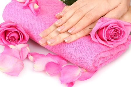 Pink towel with roses and hands on white background Stock Photo - 12092868