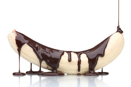 chocolate background: Banana poured with liquid chocolate isolated on white