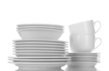 empty bowls, plates and cups isolated on white photo