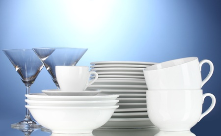 empty bowls, plates, cups and glasses on blue background Stock Photo - 12091731