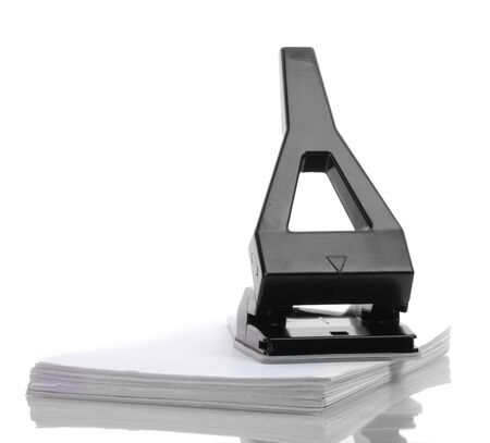 Black office hole punch with paper isolated on white photo