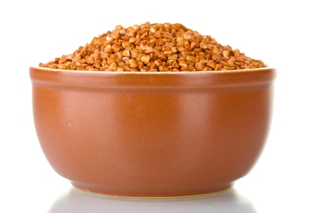 Raw buckwheat isolated on white photo