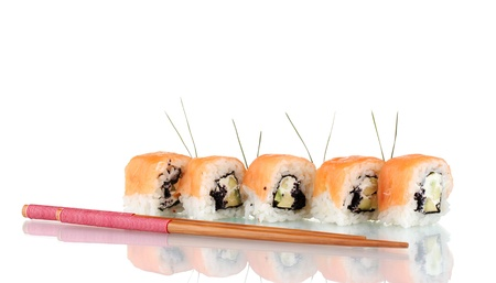 Tasty rolls in line with chopsticks isolated on white photo