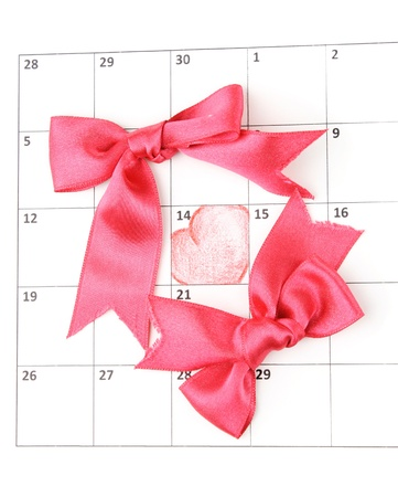 Calendar page with hearts and bows on St.Valentines Day photo