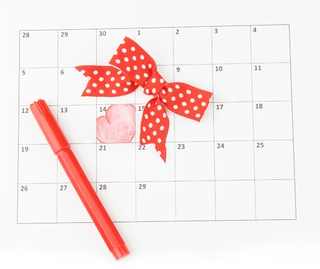 Calendar page with hearts, marker and bow on St.Valentines Day photo