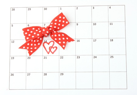 Calendar page with hearts and bow on St.Valentines Day photo