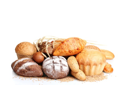 delicious breads and wheat isolated on white photo