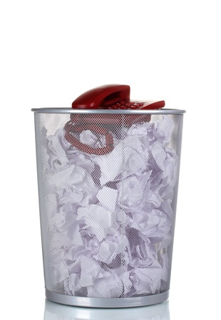 meaningless: red phone and paper in metal trash bin isolated on white Stock Photo