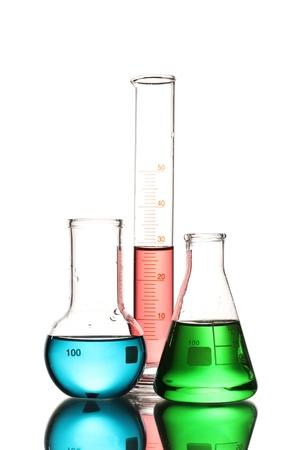 red tube: Tres frascos con líquido de color y con la reflexión aislada en blanco