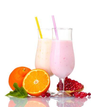 Milk shakes with fruits isolated on white photo