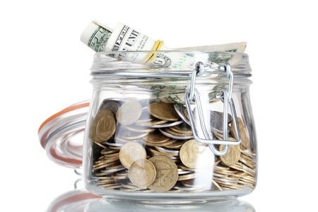Clear glass jar for tips with money isolated on white. Ukrainian coins Stock Photo - 12133867