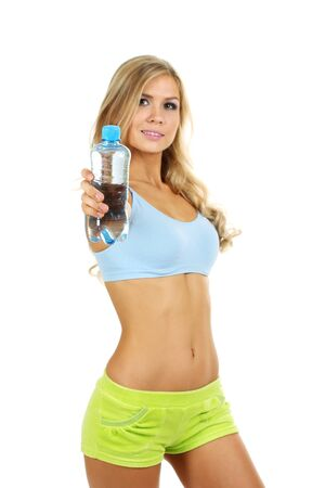 Beautiful fitness girl and  bottle of water isolated on white photo