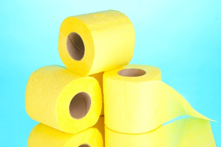 yellow rolls of toilet paper on blue background photo