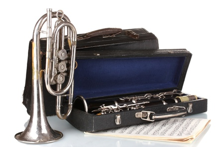 antique trumpet and clarinet in case isolated on white photo