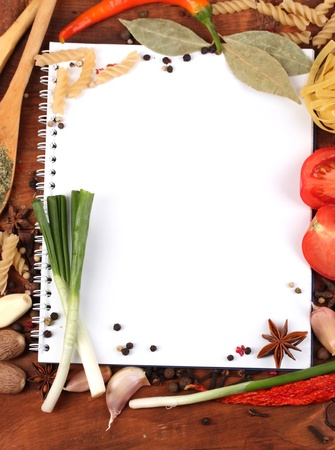 notebook for recipes and spices on wooden table Stock Photo - 12216289