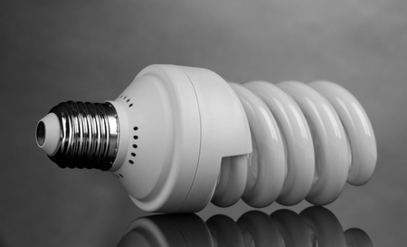 energy saving light bulb on gray background  photo