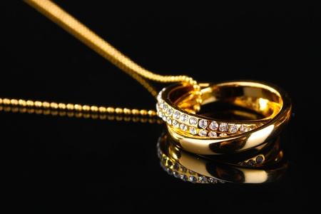 Pendant in form of rings with gem on black photo