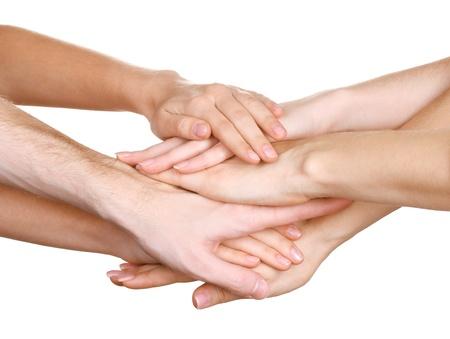manos unidas: grupo de las manos de los jóvenes aislados en blanco Foto de archivo