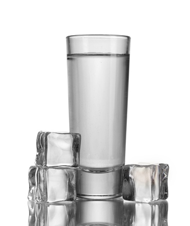 vodka: glass of vodka with ice isolaled on white Stock Photo