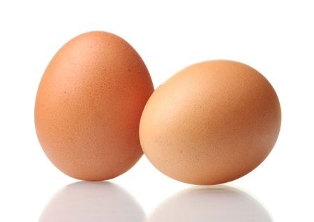 yolks: two brown eggs isolated on white Stock Photo