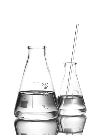 Two flasks with water and with reflection isolated on white photo