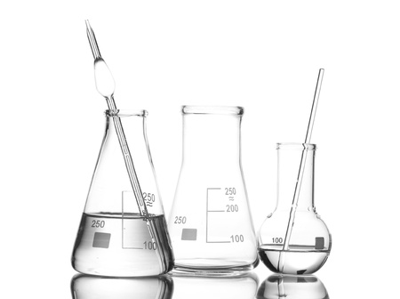 Two flasks with water and one empty flask with reflection isolated on white photo