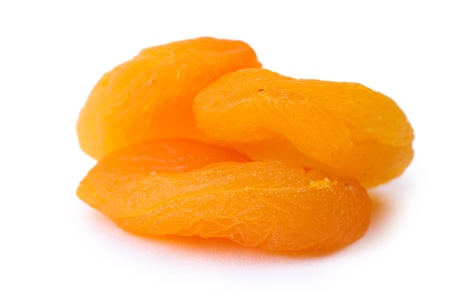 delicious dried apricots isolated on white photo