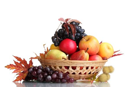 beautiful autumn harvest in basket and leaves isolated on white photo