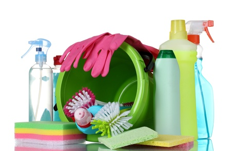 detergent bottles, brushes, gloves and sponges in bucket isolated on white photo