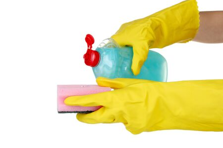 detergent bottle and sponge in hands isolated on white photo