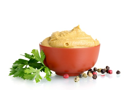 Mustard in bowl, spices and parsley isolated on white Stock Photo - 12215753