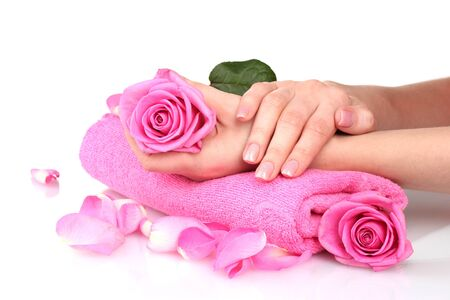 Pink towel with roses and hands on white background Stock Photo - 12217269
