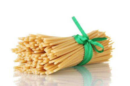 Bunch of spaghetti with ribbon isolated on white Stock Photo - 12217007