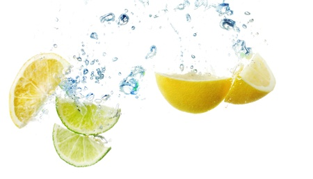 slices of lemon and lime in the water photo