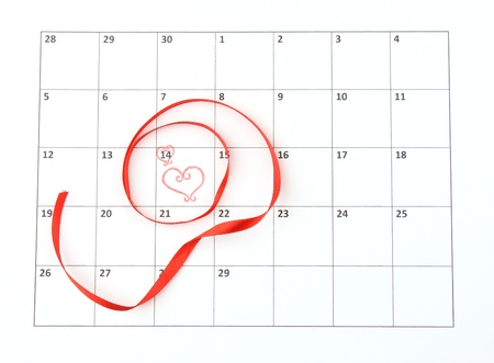 Calendar page with hearts and ribbon on St.Valentines Day photo