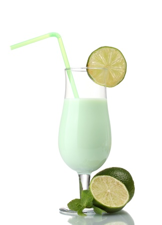 Milk shake with lime and mint isolated on white photo