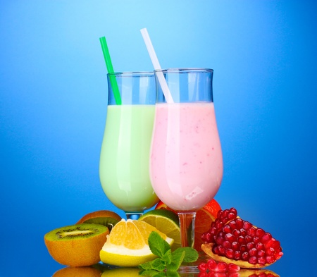 Milk shakes with fruits on blue background photo