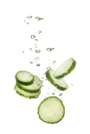 fresh sliced cucumber in water isolated on white Stock Photo - 12216683