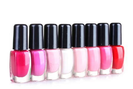 Group of nail polishes isolated on white photo