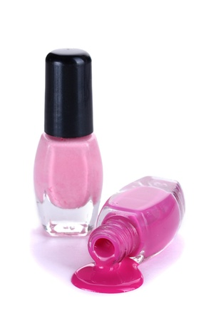 two bottles with bright nail polish isolated on white photo