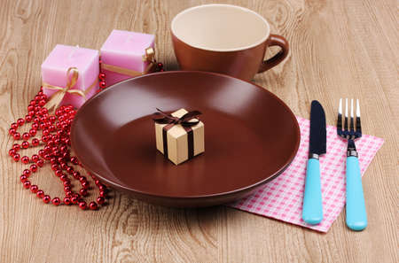 Table setting on wooden background photo