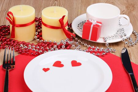 Table setting close-up on wooden background photo