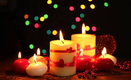 Beautiful candles on wooden table on bright background Stock Photo - 12217143