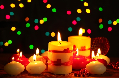 Beautiful candles on wooden table on bright background Stock Photo - 12217185