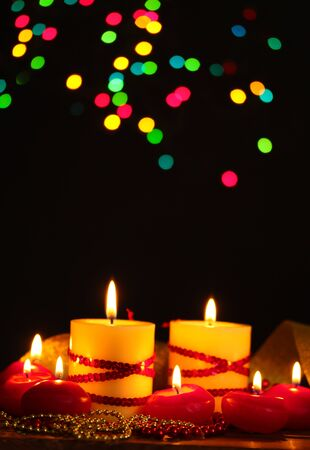Beautiful candles and decor on wooden table on bright background Stock Photo - 12217224