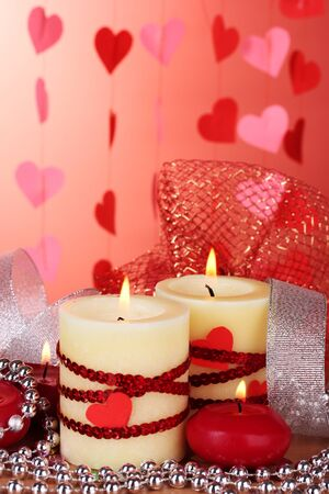 candles for Valentine's Day on wooden table on red background Stock Photo - 12217393