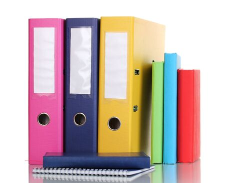 secretary tray: Bright office folders and books with stationery isolated on white Stock Photo