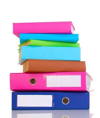 secretary tray: Bright office folders and books isolated on white