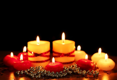 Beautiful candles and decor on wooden table on black background Stock Photo - 12217475