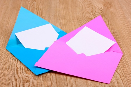 Color envelopes on wooden background Stock Photo - 12217691